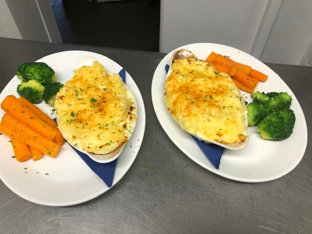Cod Salmon & Smoked Haddock in a cream white wine sauce topped with butterd mash & melted cheese
